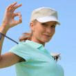 Woman with golf club — Stock Photo