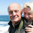 Senior couple by the coast — Stock Photo #11749728