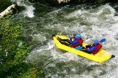 Two kayaking down river rapids — Stock Photo