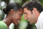 Close up of a mixed race couple touching foreheads — Stock Photo