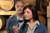 Woman tasting wine in cellar — Stock Photo