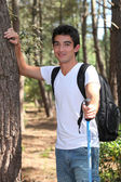 Young man walking in the woods — Stock Photo