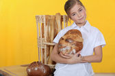 Little girl baking bread — Stock Photo