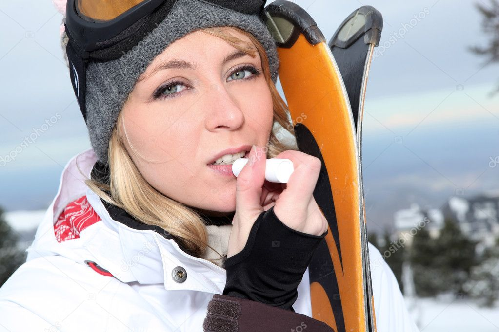 Blond skier applying lip balm — Stock Photo #11746196
