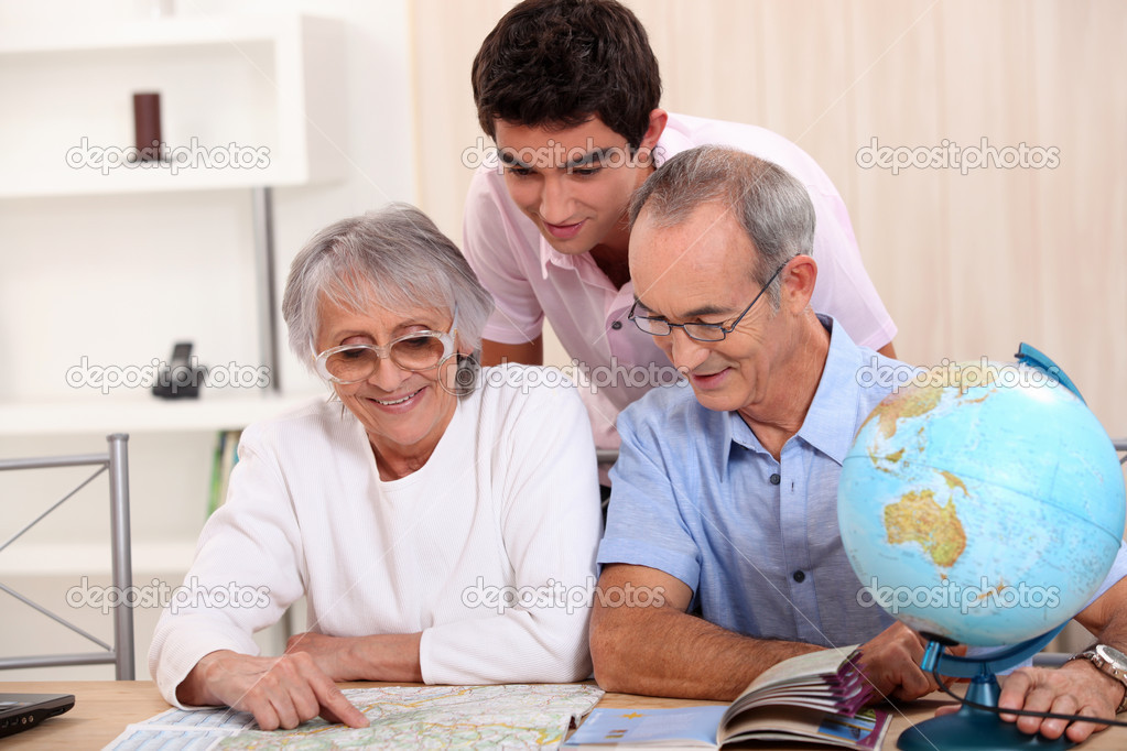 Grandparents and grandson preparing travel  Stock Photo #11748529