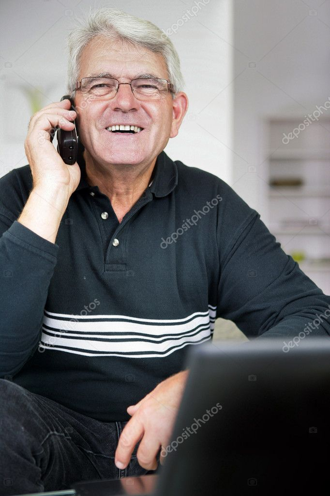 Senior man laughing whilst on the telephone — Stock Photo #11749780