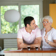Stock Photo: Adult mwith his mother in kitchen