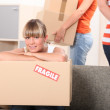 Young woman moving home — Stock Photo #11750407