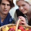 Couple with basket of apples — Stock Photo