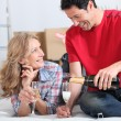 Couple celebrating moving into new home with champagne - Stockfoto