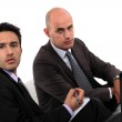 Businessmen looking at a laptop — Stock Photo