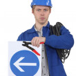 Electrician with a one way sign — Stock Photo