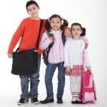 Schoolchildren with backpacks — Stock Photo