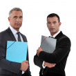 A team of businessmen holding folders — Stock Photo