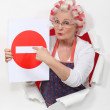 Woman with curlers and no trespassing sign — Stock Photo #11752278