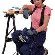 Womwith chainsaw — Stock Photo #11752302