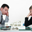 Two uninspired architects sat by model housing — Stock Photo #11752326