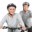 Elderly couple cycling — Stock Photo