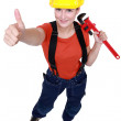 Woman holding wrench and giving thumbs-up — Stock Photo #11753252
