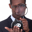 Man looking through a magnifying glass — Stock Photo #11753297