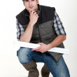 A pensive tradesman - Stock Photo