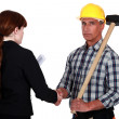 Tradesman shaking the hand of an engineer — Stock Photo #11754645