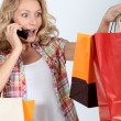 Enthusiastic woman after shopping frenzy — Stock Photo