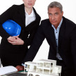 Architect with proposal for new building — Stock Photo