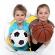 Stock Photo: Children with football and basketball