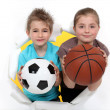 Children with football and basketball — Stock Photo #11756007