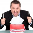 Businessman devouring a pile of paperwork — Stock Photo