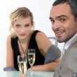Successful couple toasting with champagne — Stock Photo