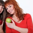 Duo of girls with apples — Stock Photo #11756518