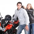 Couple posing next to motorcycle — Stock Photo