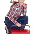 Stock Photo: Portrait of tradeswomwith pipe wrench and toolbox