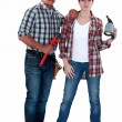 Stock Photo: Male and female plumbers