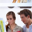Stock Photo: Couple in library