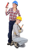A team of cheerful tradeswomen — Stock Photo