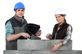 Couple constructing wall — Stock Photo