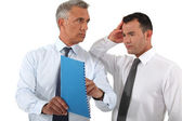 Businessman reprimanding his employee — Stock Photo