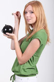 Portrait of a young woman with money box — Stockfoto