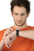 Man checking his wristwatch for the time — Stock Photo