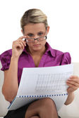 Blond businesswoman going hover her commitments — Stock Photo