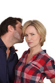 Man whispering a secret to his partner — Stock Photo