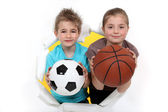 Children with a football and basketball — Stock Photo