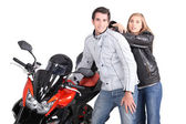 Couple posing next to motorcycle — Stock Photo