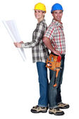 Tradespeople standing back to back — Stock Photo