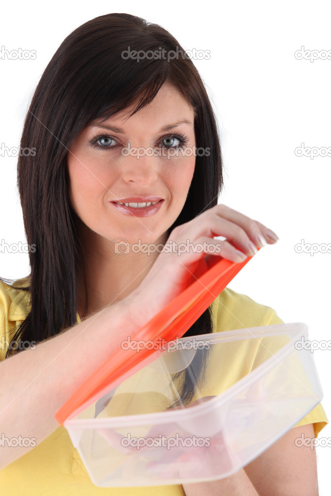 Woman opening food storage box — Stock Photo #11754727