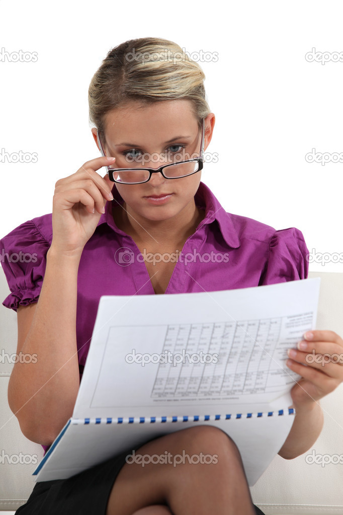 Blond businesswoman going hover her commitments — Stock Photo #11755335
