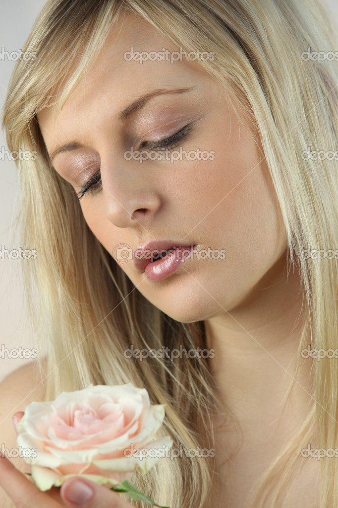 Blonde woman with rose — Stock Photo #11759310